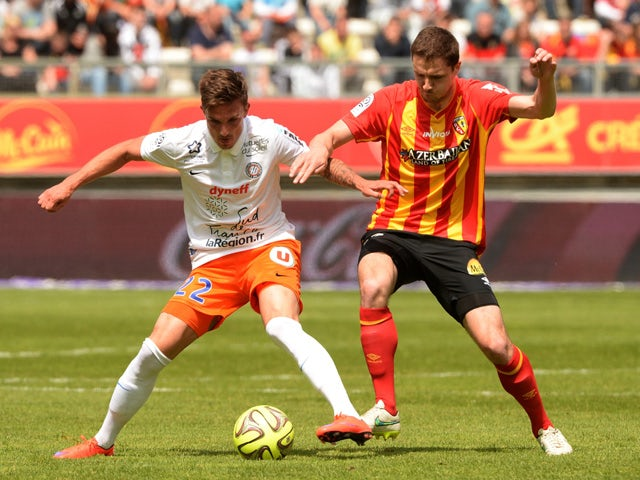 Lens' French midfielder Alharbi El Jadeyaoui vies with Montpellier's French midfielder Benjamin Stambouli during the French Ligue 1 football match Lens vs Montpellier at the Licorne stadium in Amiens on May 10, 2015