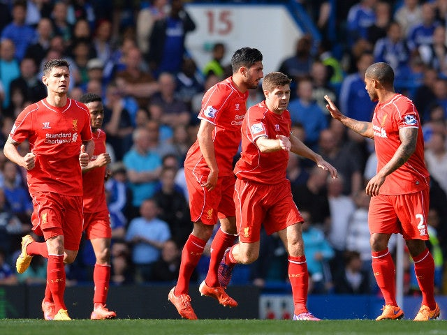 Liverpool captain Steven Gerrard celebrates with teammates after equalising for his side against Chelsea at Stamford Bridge on May 10, 2015
