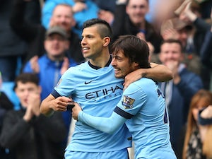 Sergio Aguero of Manchester City is congratulated by teammate David Silva of Manchester City after scoriing the opening goal during the Barclays Premier League match between Manchester City and Queens Park Rangers at the Etihad Stadium on May 10, 2015