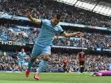 Manchester City's Argentinian striker Sergio Aguero celebrates his goal during the English Premier League football match between Manchester City and Queens Park Rangers at the Etihad Stadium in Manchester, northwest England, on May 10, 2015