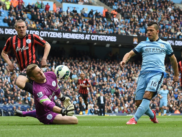 Manchester City's Argentinian striker Sergio Aguero shoots to score during the English Premier League football match between Manchester City and Queens Park Rangers at the Etihad Stadium in Manchester, northwest England, on May 10, 2015