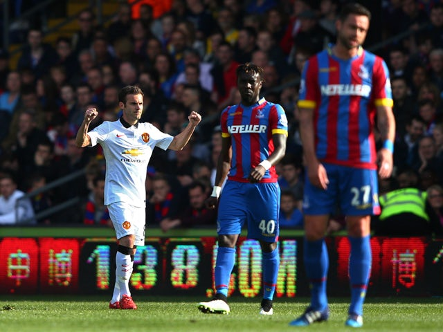 Juan Mata of Manchester United celebrates scoring his penalty during the Barclays Premier League match between Crystal Palace and Manchester United at Selhurst Park on May 9, 2015