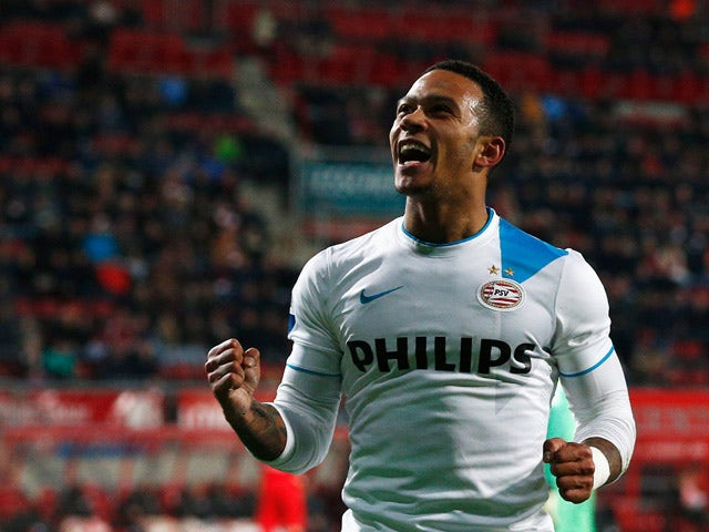 Memphis Depay of PSV celebrates after he scores the fifth goal of the game for his team during the Dutch Eredivisie match between FC Twente and PSV Eindhoven held at De Grolsch Veste Stadium on April 4, 2015