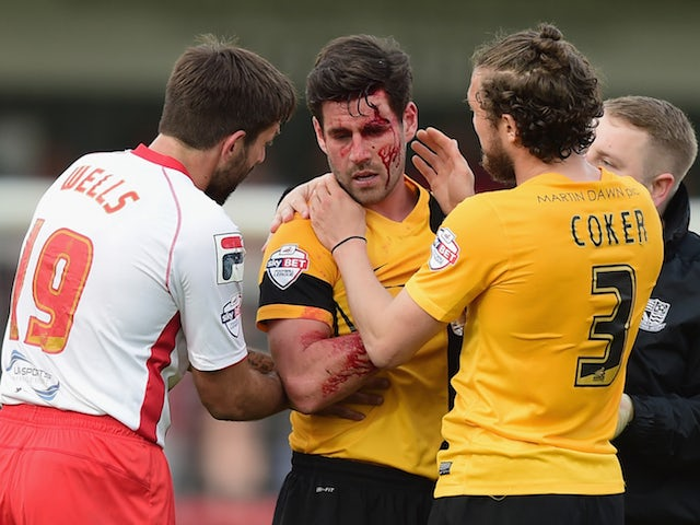 Michael Timlin of Southend United recieves treatment during the Sky Bet League 2 Playoff Semi-Final between Stevenage and Southend United at The Lamex Stadium on May 10, 2015