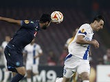 Dnipro's forward from Croatia Nikola Kalinic fights for the ball with Napoli's defender from Spain Raul Albiol during the UEFA Europa League semi final first leg football match SSC Napoli vs FK Dnipro Dnipropetrovsk on May 7, 2015