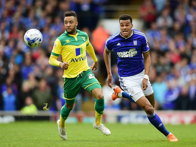 Nathan Redmond of Norwich closes down Tyrone Mings of Ipswich during the Sky Bet Championship Playoff semi-final first leg match between Ipswich Town and Norwich Cityat Portman Road on May 9, 2015