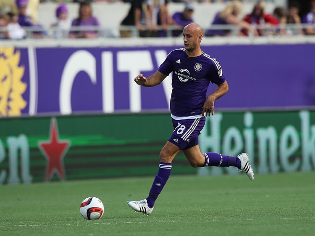 Aurelien Collin #78 of Orlando City SC chases the ball during an MLS soccer match between the New York City FC and the Orlando City SC at the Orlando Citrus Bowl on March 8, 2015