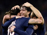 Paris Saint-Germain's Brazilian defender Maxwell is congratuled by teammates after scoring a goal during the French L1 football match between Paris Saint-Germain and Guingamp on May 8, 2015