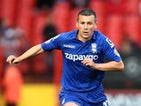 Birmingham City's Paul Caddis looks for a pass during his side's Championship clash with Charlton Athletic on October 4, 2014