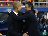 Bayern Munich's Spanish head coach Pep Guardiola (L) and Barcelona's coach Luis Enrique greet each other before the UEFA Champions League football match FC Barcelona vs FC Bayern Muenchen at the Camp Nou stadium in Barcelona on May 6, 2015