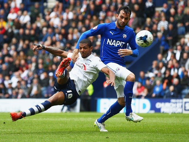 Jermaine Beckford of Preston North End holds off Sam Hird of Chesterfield to score their first goal during the Sky Bet League One Playoff Semi-Final second leg match between Preston North End and Chesterfield at Deepdale on May 10, 2015