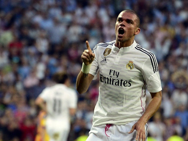 Real Madrid's Portuguese defender Pepe celebrates after scoring during the Spanish league football match Real Madrid CF vs Valencia CF at the Santiago Bernabeu stadium in Madrid on May 9, 2015