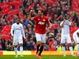 Manchester United's English defender Rio Ferdinand celebrates scoring his team's second and winning goal during the English Premier League football match between Manchester United and Swansea City at Old Trafford in Manchester, northwest England, on May 1
