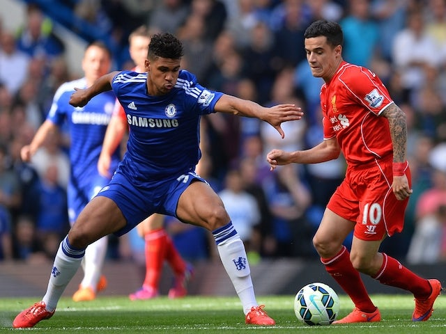 Chelsea's English midfielder Ruben Loftus-Cheek (L) prepares to challenge Liverpool's Brazilian midfielder Philippe Coutinho (R) during the English Premier League football match between Chelsea and Liverpool at Stamford Bridge in London on May 10, 2015