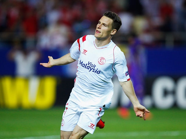 Kevin Gameiro of Sevilla celebrates scoring his team's third goal during the UEFA Europa League Semi Final first leg match between FC Sevilla and ACF Fiorentina at Estadio Ramon Sanchez Pizjuan on May 7, 2015