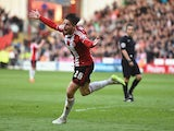 Kieron Freeman of Sheffield United battles celebrates scoring the opening goal during the Sky Bet Championship semi final match first leg match between Sheffield United and Swindon Town at Bramall Lane on May 7, 2015
