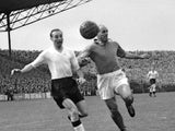 English forward Stanley Matthews and French defender Roger Marche run after the ball during the soccer match between France and England 13 May 1955