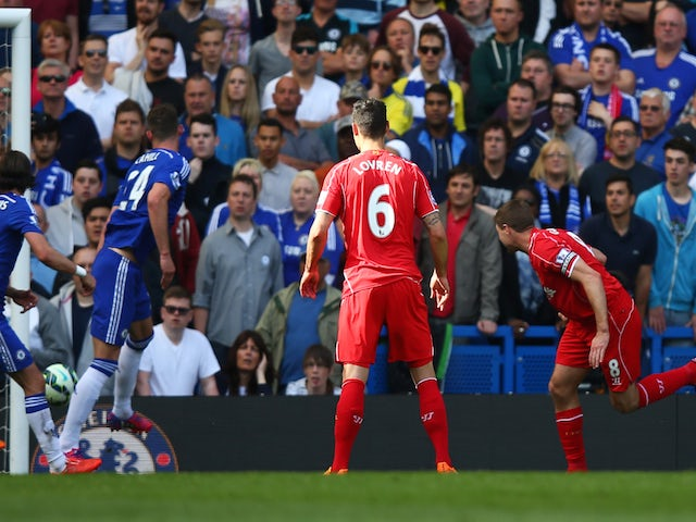 Steven Gerrard (R) of Liverpool scores a goal to level the scores at 1-1 during the Barclays Premier League match between Chelsea and Liverpool at Stamford Bridge on May 10, 2015
