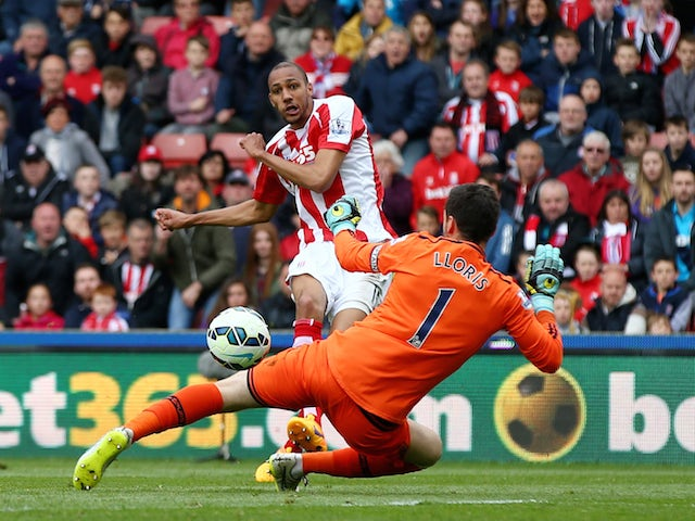 Steven N'Zonzi of Stoke City scores his team's second goal past Hugo Lloris of Tottenham Hotspur during the Barclays Premier League match between Stoke City and Tottenham Hotspur at Britannia Stadium on May 9, 2015
