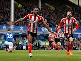 Jermain Defoe of Sunderland celebrates scoring his team's second goal with Steven Fletcher (R) during the Barclays Premier League match between Everton and Sunderland at Goodison Park on May 9, 2015