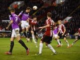 Sam Ricketts of Swindon Town scores the equalising goal during the Sky Bet Championship semi final match first leg match between Sheffield United and Swindon Town at Bramall Lane on May 7, 2015