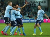 Alex Brosque of Sydney FC celebrates with his team mates after scoring a goal during the A-League Semi Final match between Sydney FC and Adelaide United at Allianz Stadium on May 9, 2015