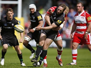 Tomas O'Leary of London Irish is hit by a late tackle by Matt Kvesic of Gloucester during the Aviva Premiership match between Gloucester Rugby and London Irish at Kingsholm Stadium on May 9, 2015