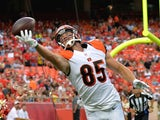 Tyler Eifert #85 of the Cincinnati Bengals attempts to pull in the ball against Derrick Johnson #56 of the Kansas City Chiefs at Arrowhead Stadium on August 7, 2014