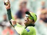 Umar Akmal of Pakistan celebrates catching out Stuart Thompson of Ireland in the 2015 Cricket World Cup Pool B match between Pakistan and Ireland at the Adelaide Oval on March 15, 2015