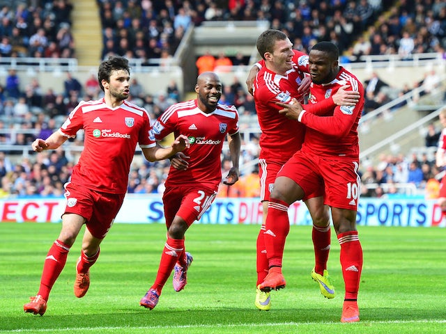 Victor Anichebe of West Brom celebrates scoring the opening goal with team mates during the Barclays Premier League match between Newcastle United and West Bromwich Albion at St James' Park on May 9, 2015