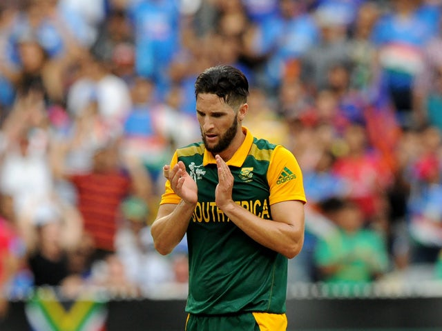 South Africa's Wayne Parnell celebrates after taking a wicket during the Pool B 2015 Cricket World Cup match between South Africa and India at the Melbourne Cricket Ground (MCG) on February 22, 2015