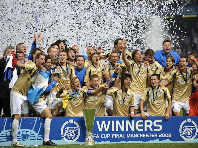 Zenit St Petersburg players celebrate with the trophy after the UEFA Cup final match between Scottish football club Glasgow Rangers and Russian side Zenit St Petersburg at Manchester City stadium on May 14, 2008
