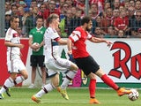 Freiburg's Swiss forward Admir Mehmedi (R) scores the 1-1 during the German first division Bundesliga football match SC Freiburg vs FC Bayern Munich in Freiburg, southern Germany, on May 16, 2015