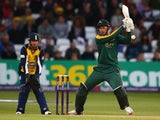 Alex Hales of Nottinghamshire hits the ball towards the boundary, as Tim Ambrose of Warwickshire looks on during the NatWest T20 Blast match between Nottinghamshire and Warwickshire at Trent Bridge on May 15, 2015