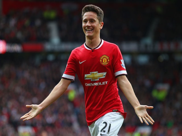 Ander Herrera of Manchester United celebrates as he scores their first goal during the Barclays Premier League match between Manchester United and Arsenal at Old Trafford on May 17, 2015
