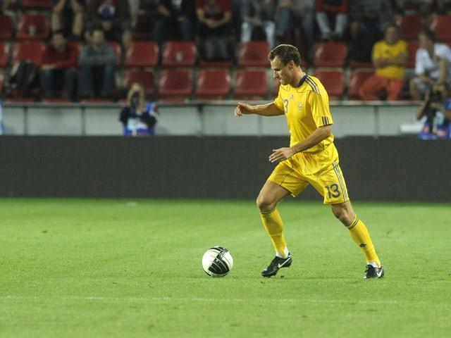 Artem Fedetskyi of Ukraine runs with a ball during a friendly football match against Czech Republic on September 06, 2011