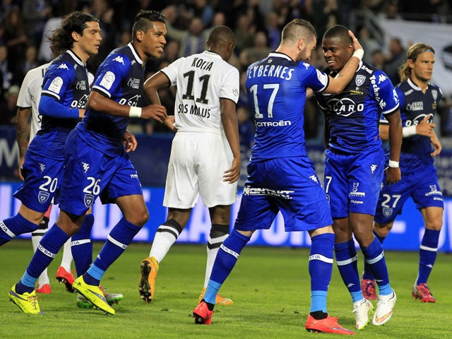 Bastia's French midfeilder Floyd Ayite is congratulated by teammates after scoring a goalduring the French L1 football match between Bastia and Caen on May 16, 2015