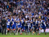 Bristol Rovers players celebrate as Lee Mansell of Bristol Rovers (not pictured) scores the winning penalty in the shoot out during the Vanarama Conference Playoff Final match between Grimsby Town and Bristol Rovers at Wembley Stadium on May 17, 2015