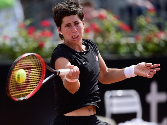 Carla Suarez Navarro of Spain in action during her Quarter Final against Petra Kvitova of Czech Republic on Day Six of The Internazionali BNL d'Italia 2015 at the Foro Italico on May 15, 2015