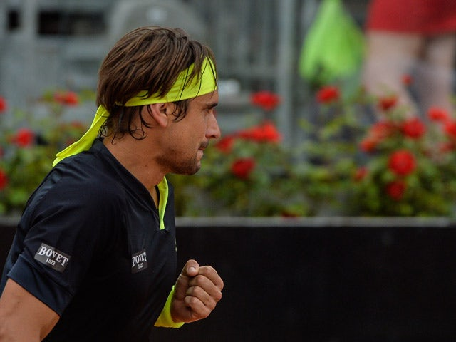 David Ferrer of Spain celebrates after winning a point against Belgium's David Goffin during their ATP Tennis Open match in Rome on May 15, 2015