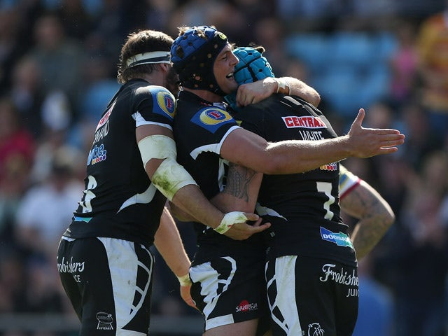 Ben White of Exeter celebrates with team mates after scoring a try during the Aviva Premiership match between Exeter Chiefs and Sale Sharks at Sandy Park on May 16, 2015