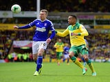 Freddie Sears of Ipswich Town holds off Martin Olsson of Norwich City during the Sky Bet Championship Playoff semi final second leg match between Norwich City and Ipswich Town at Carrow Road on May 16, 2015