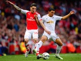 Hector Bellerin of Arsenal and Jefferson Montero of Swansea City battle for the ball during the Barclays Premier League match between Arsenal and Swansea City at Emirates Stadium on May 11, 2015