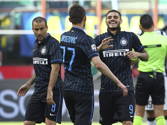 Mauro Emanuel Icardi (R) of FC Internazionale Milano celebrates with his team-mates Marcelo Brozovic (C) and Rodrigo Palacio (L) after scoring the opening goal during the Serie A match between FC Internazionale Milano and Juventus FC at Stadio Giuseppe Me