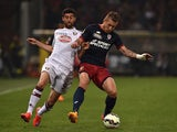 Juraj Kucka (L) of Genoa CFC is challenged by Marco Benassi of Torino FC during the Serie A match between Genoa CFC and Torino FC at Stadio Luigi Ferraris on May 11, 2015