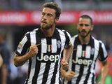Claudio Marchisio of Juventus FC celebrates his goal during the Serie A match between FC Internazionale Milano and Juventus FC at Stadio Giuseppe Meazza on May 16, 2015