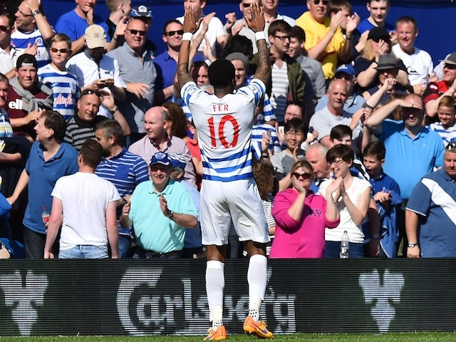Queens Park Rangers' Dutch midfielder Leroy Fer celebrates after scoring his teams second goal to take a 2-1 lead during the English Premier League football match between Queens Park Rangers and Newcastle United at Loftus Road in London on May 16, 2015