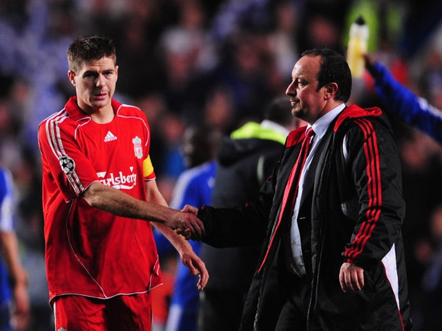 Steven Gerrard of Liverpool is consoled by manager Rafael Benitez in defeat following the UEFA Champions League Semi Final 2nd leg match between Chelsea and Liverpool at Stamford Bridge on April 30, 2008