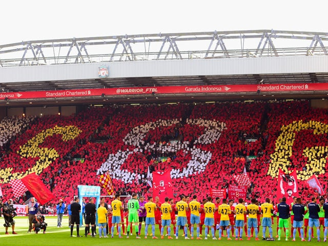 Crystal Palace and Liverpool players form a guard of honour for Steven Gerrard of Liverpool during the Barclays Premier League match between Liverpool and Crystal Palace at Anfield on May 16, 2015