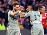 Marseille's French forward Andre-Pierre Gignac is congratulated by Marseille's French forward Dimitri Payet after scoring a goal during the French Ligue 1 football match between Lille and Marseille on May 16, 2015